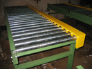 Chain driven roller conveyor